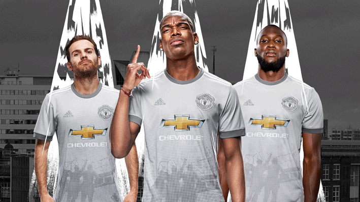 Manchester United third shirt shows the United Trinity Statue outside Old Trafford.