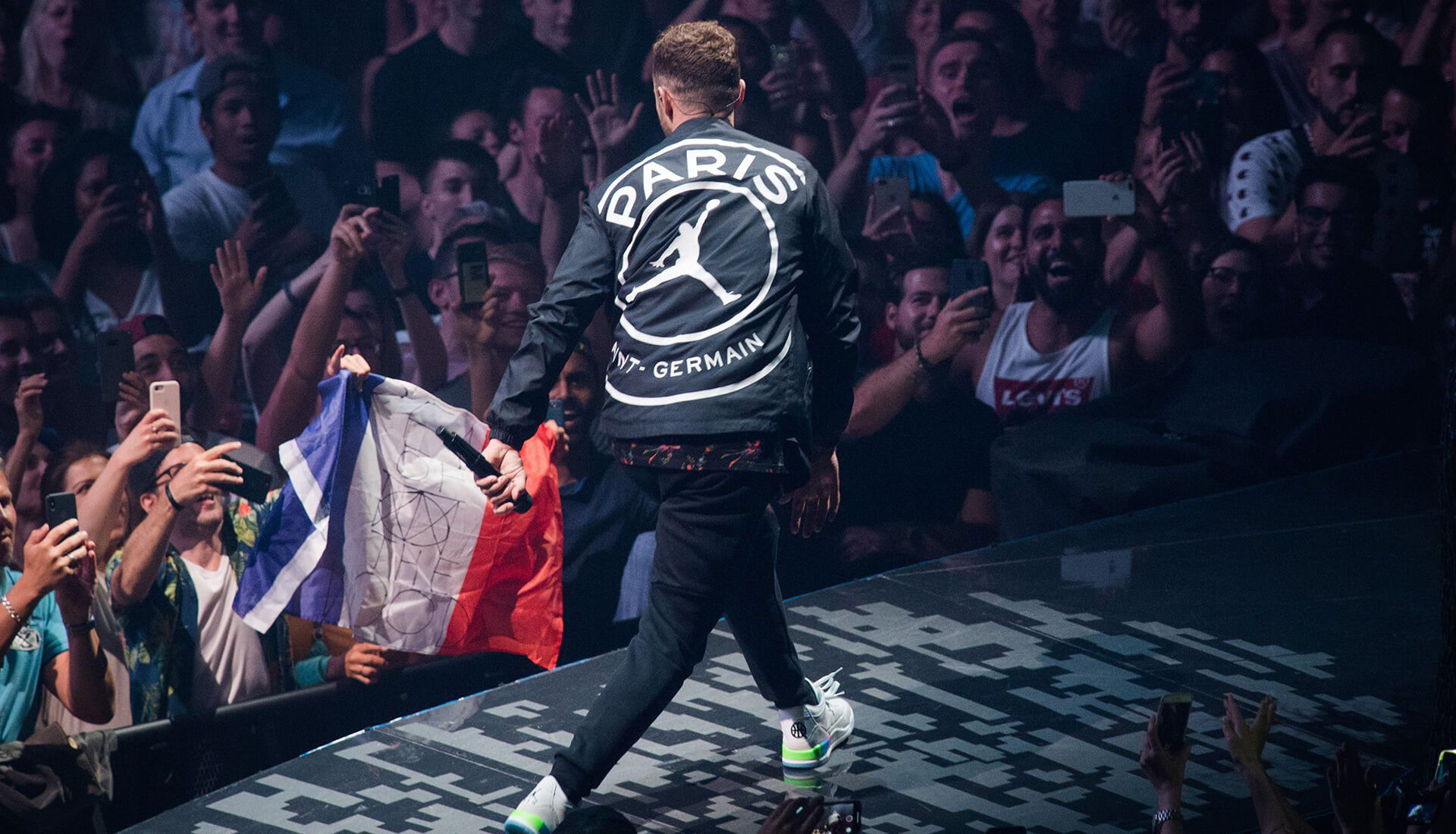 Justin Timberlake wearing the Jordan x PSG Jacket and the Quai54 Retro 3 Friends & Family
